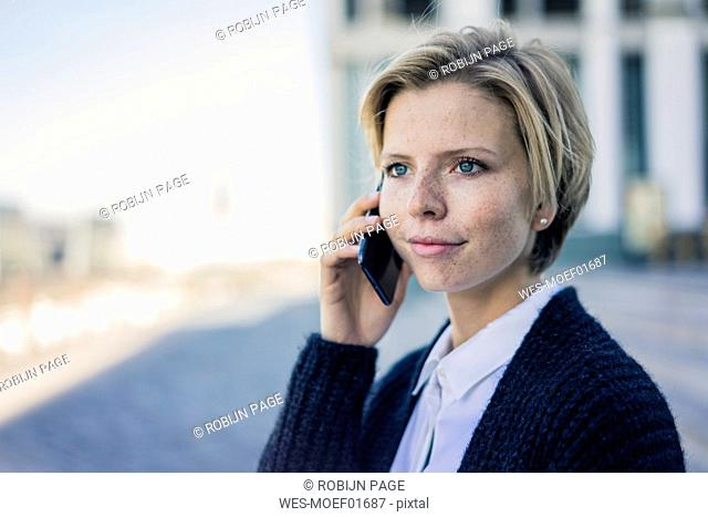 Young businesswoman using mobile phone