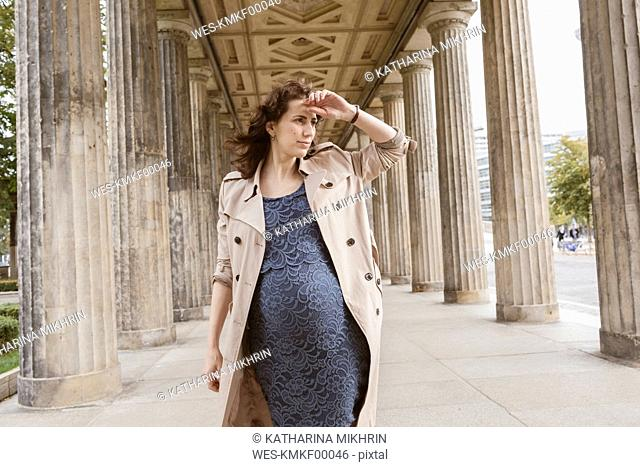 Germany, Berlin, Museumsinsel, pregnant woman watching something