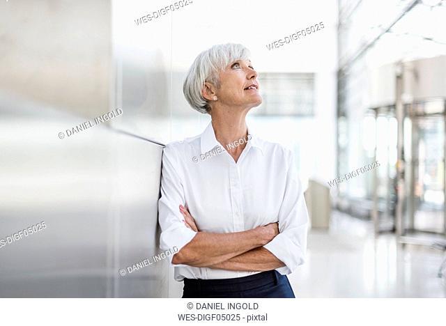 Portrait of senior businesswoman looking up
