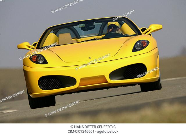 Car, Ferrari F430 Spider, model year 2005-, yellow, Convertible, driving, diagonal from the front, frontal view, open top, country road