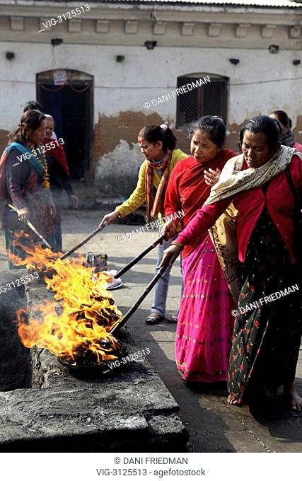 Women perform a ritual called Lakha Batti at the Pashupatinath temple complex in Nepal. This ritual is said to ensure and protect the welfare of three...