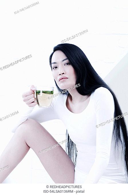 Woman having cup of tea