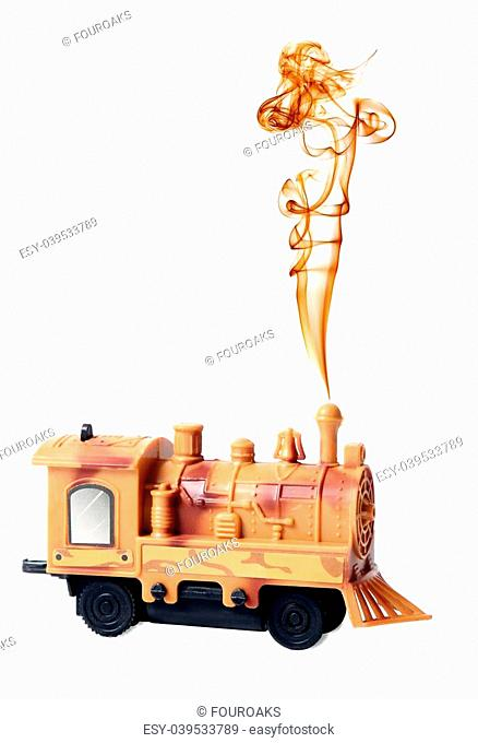 Toy steam engine or locomotive with chimney smoke