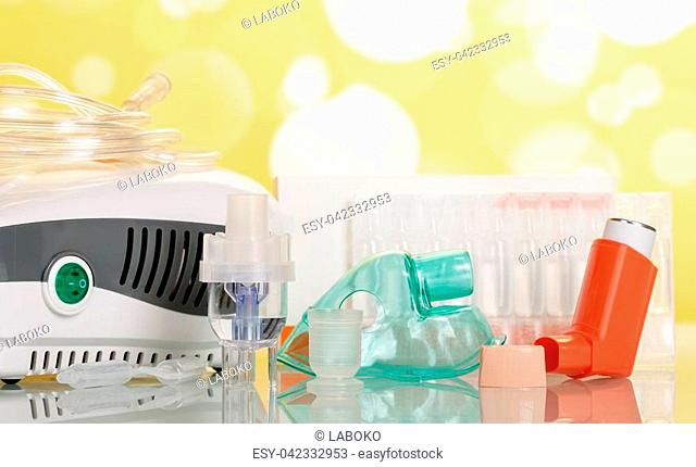 Two types of inhalation devices, children's mask and liquid for inhalation, on light yellow background