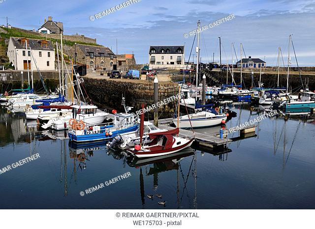 Morning at Banff Harbour marina with docked boats and sailboats on Banff Bay Moray Firth Aberdeenshire Scotland UK