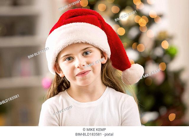 Caucasian girl wearing Santa hat