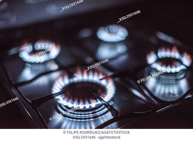 Rings of fire: four lighted gas stove burners