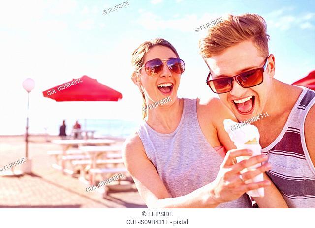 Couple with ice cream smiling