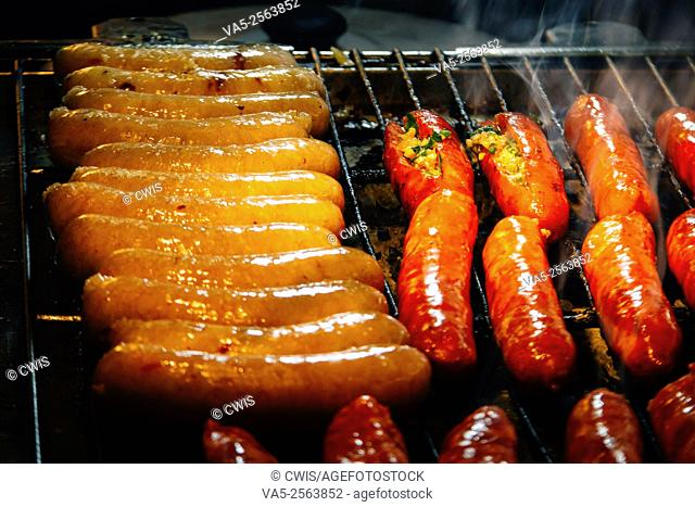 "Shilin Night Market, Taipei, Taiwan - Close up of many sausages on the grille, it's a yammy Taiwanese snack named """"Small sausage in big sausage"""""