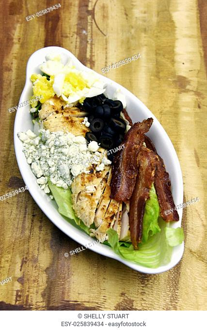 Bacon with chicken, blue cheese, egg and olives