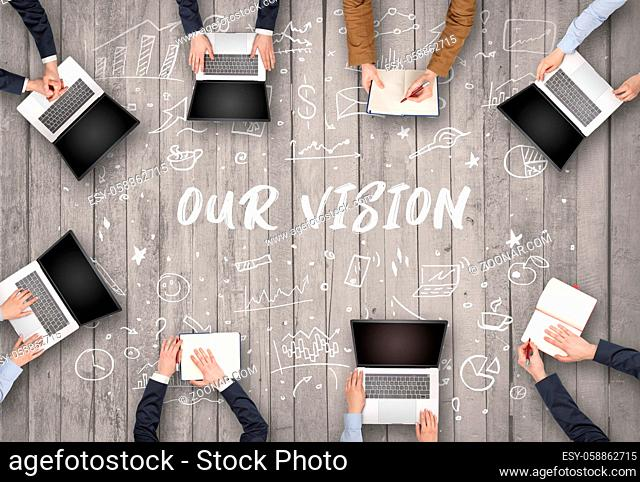 Group of business people working in office with OUR VISION inscription, coworking concept
