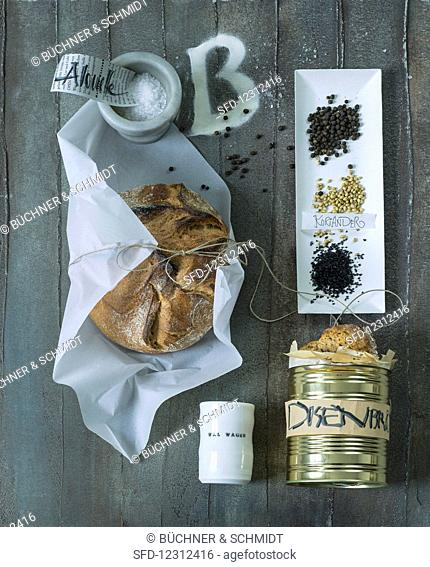 A loaf of bread, canned bread and various spices
