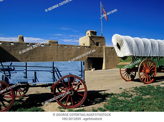 Bent's Old Fort with covered wagon & cart, Bent's Old Fort National Historic Site, Colorado
