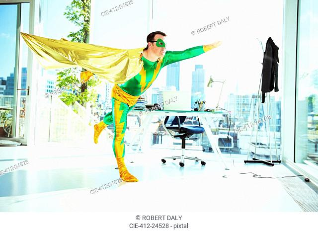 Superhero flying in office
