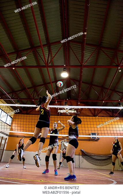 Volleyball player spiking the ball during a volleyball match