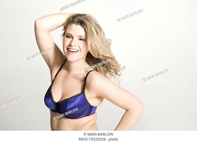 Sexy young woman wearing bra smiling