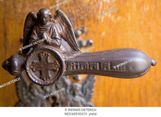 Iron door handle, angel-shaped, close up