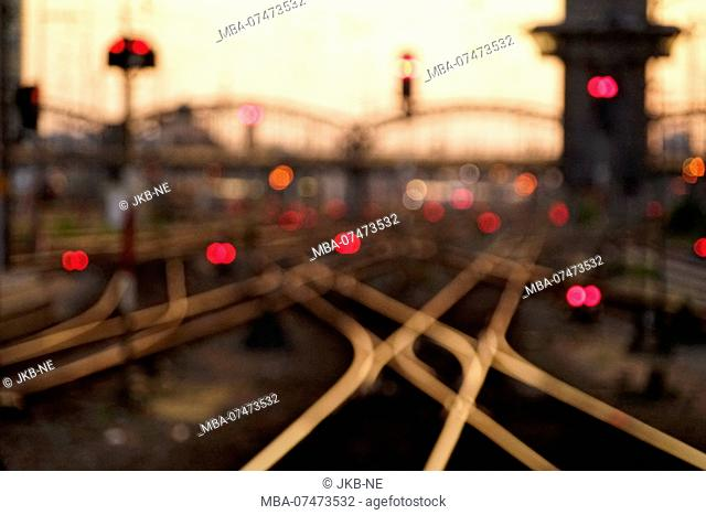 Germany, Bavaria, Munich, central station, track with crossing, evening mood, out of focus, blurred