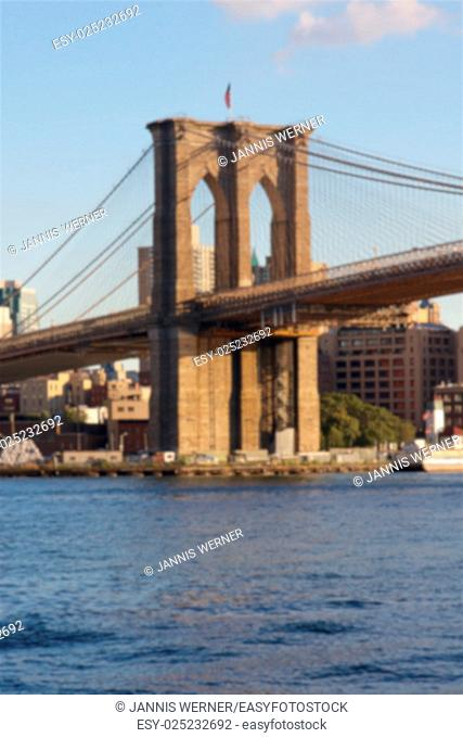 Blurred background of East tower of the Brooklyn Bridge as seen from Lower Manhattan, New York, NY, USA