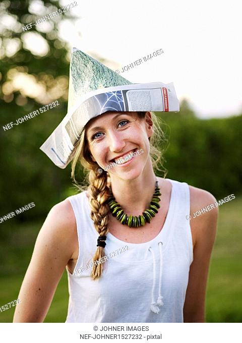 Smiling woman wearing paper hat