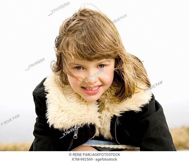 A happy mixed race girl hispanic/latin & caucasian in cold weather
