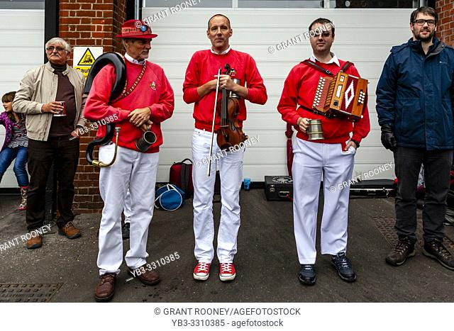 Morris Dancer Musicians Pose For A Photo At The Annual â. . Dancing in the Oldâ. . Event in Harveys Brewery Yard To Celebrate The Return Of The â
