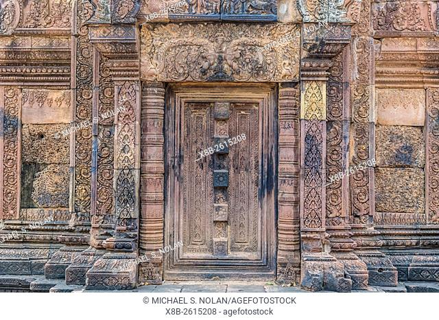 Ornate carvings in red sandstone at Banteay Srei Temple in Angkor, Siem Reap Province, Cambodia, Khmer
