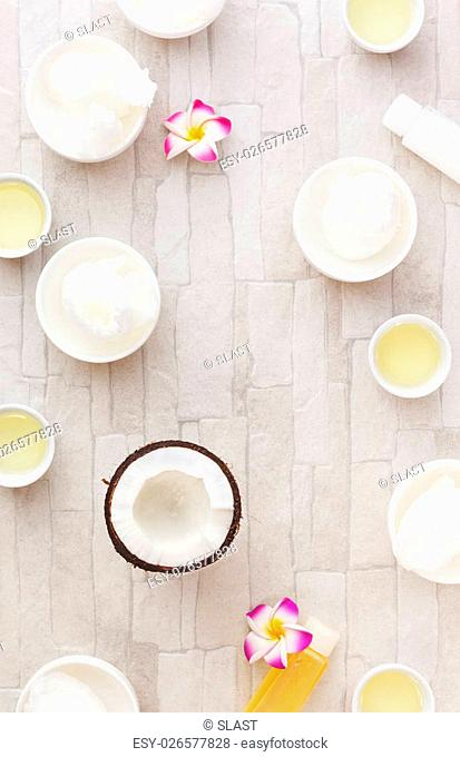 Bowls of coconut oil and fresh coconut, still life pattern background. Overhead view