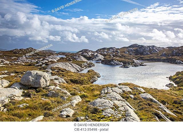 Sunny clouds over craggy rocks and water, Golden Road, Harris, Outer Hebrides