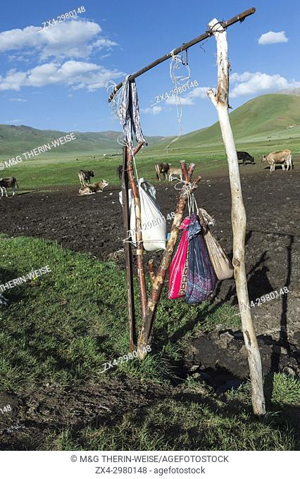 Kumis milk fermenting outside in bags, Song Kol Lake, Naryn province, Kyrgyzstan, Central Asia