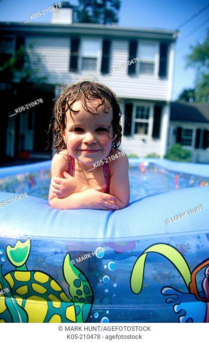 Girl (3yr) in an inflatable pool