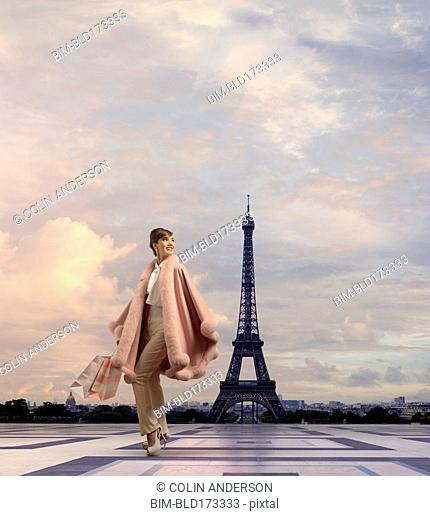 Pacific Islander woman walking near Eiffel Tower, Paris, Ile