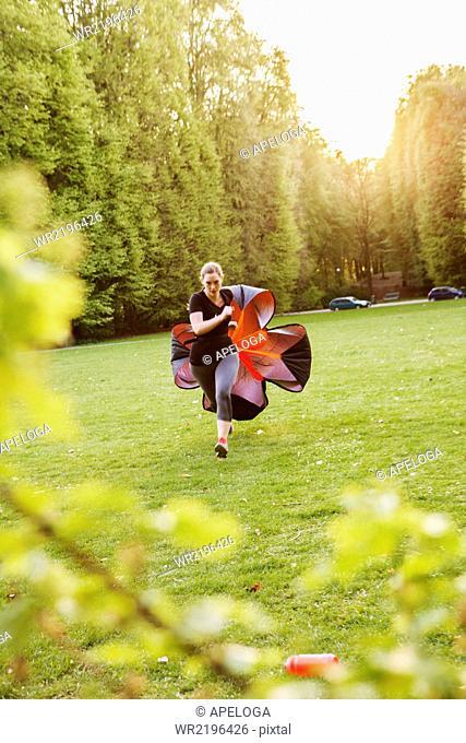 Women exercising in park against sky