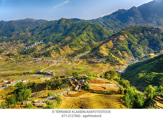Terraced rice fields on the hillside with Ta Van village in the valley near Sapa, Vietnam, Asia