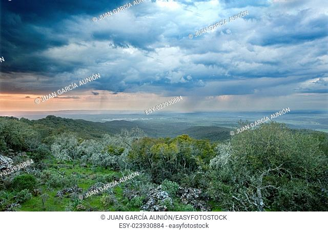 Majestic sunset in the mountains landscape. Overcast sky before storm. Alor Mountains, Spain