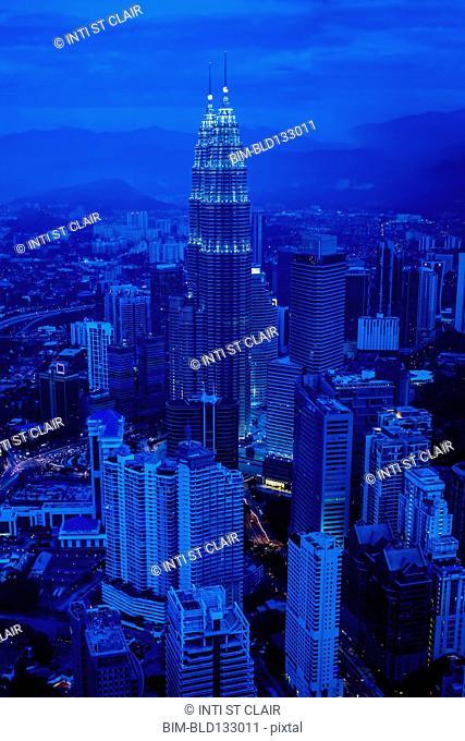 View of city skyline lit up at night, Kuala Lumpur, Malaysia