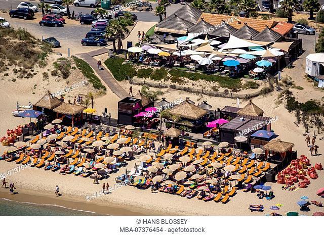 Cap d'Agde Nude Resort, naturist village at Cap d'Agde, beach bar on the beach of Agde, parasols, Marseillan, Hérault department, Occitanie region, France