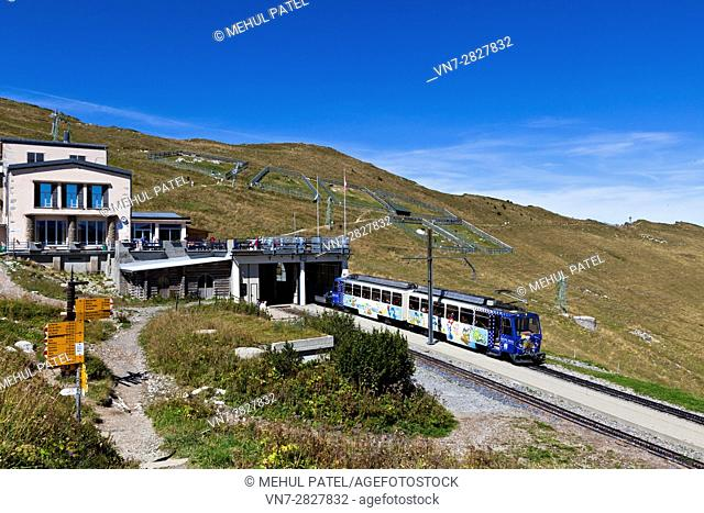 Cog railway train at station of Rochers-de-Naye close to summit of the mountain, Switzerland, Europe. The train arrives from and departs to Montreux by Lake...