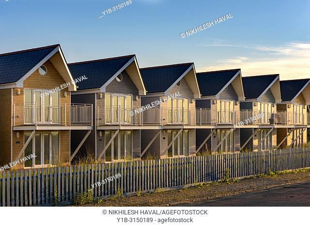 Row of seaside beach Chalets, Isle of Wight, UK