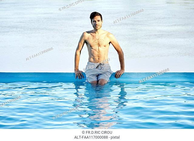 Young man in swimming pool