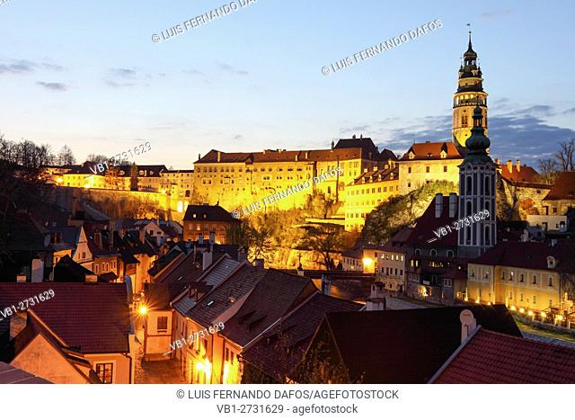 Cesky Krumlov castle and old town lighted at dusk