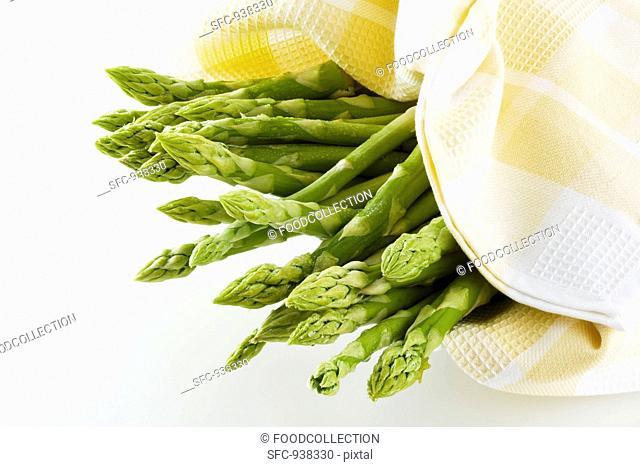 Green asparagus in tea towel