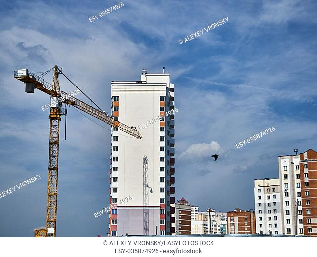 Photos show home, sky, clouds. Beautiful view of the buildings. Photos were taken in summer in Sunny weather, bright blue sky and clouds
