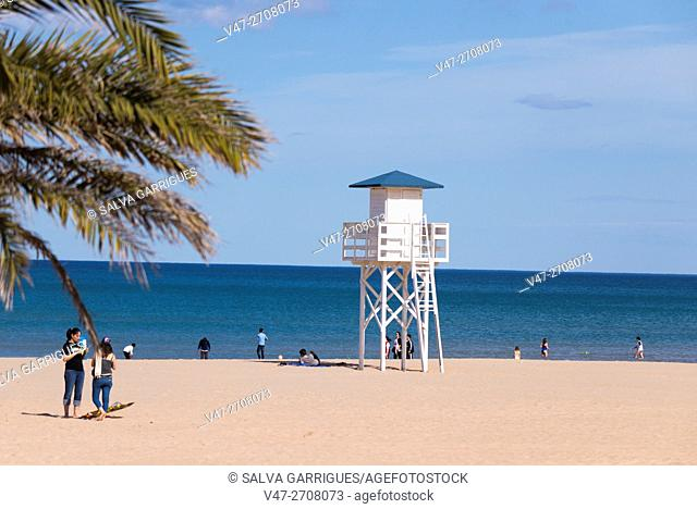People enjoying a sunny day on the beach in Gandia, Valencia, Spain, Europe