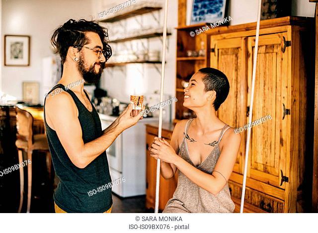 Couple on indoor swing