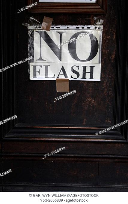 no flash photography sign on church door in rome italy