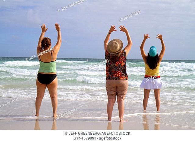 Florida, Miami Beach, Atlantic Ocean, shore, surf, waves, yoga class, woman, women, exercising