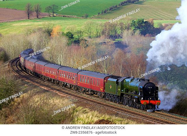 Steam locomotive LMS Royal Scot Class 46115 Scots Guardsman near Low Baron Wood Farm Armathwaite, Eden Valley, Cumbria, England, UK