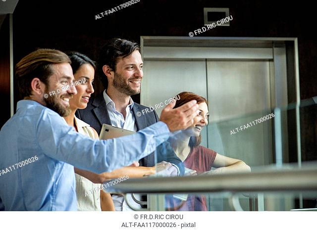 Business people standing on hotel balcony