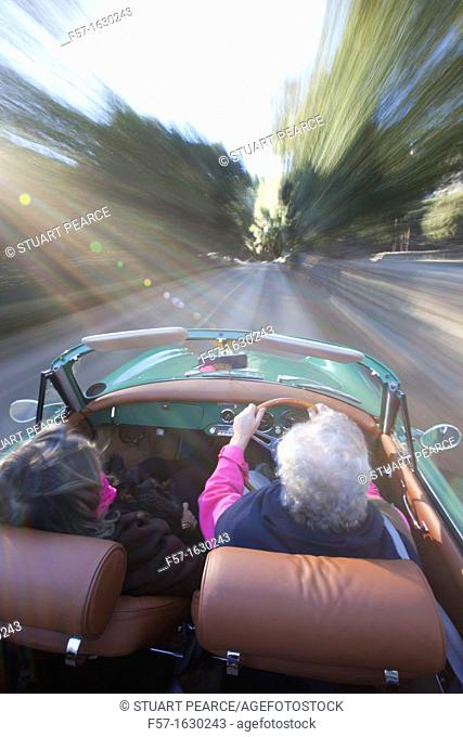 Retired couple driving their Classic 1959 Porsche 356A Cabriolet